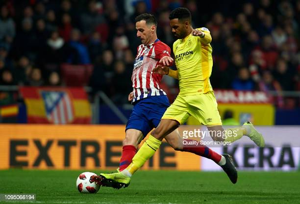 Nikola Kalinic of Atletico Madrid competes for the ball with Jonas Ramalho of Girona during the Copa del Rey Round of 16 second leg match between...