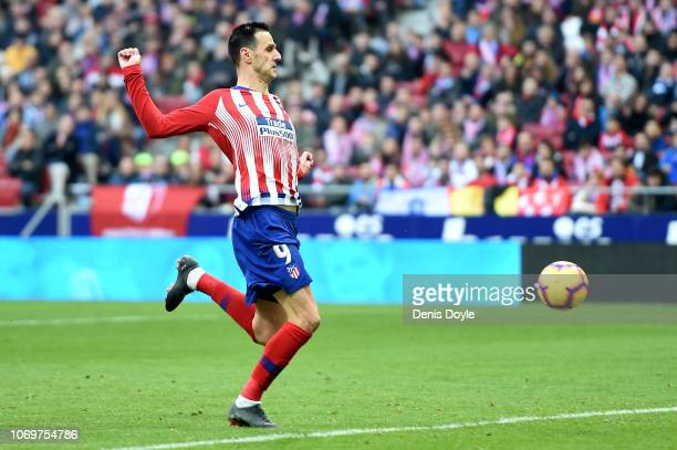 Nikola Kalinic of Atletico Madrid scores his team's first goal during the La Liga match between Club Atletico de Madrid and Deportivo Alaves at Wanda...