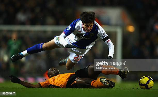 Nikola Kalinic of Blackburn Rovers is tackled by George Boateng of Hull during the Barclays Premier League match between Blackburn Rovers and Hull...