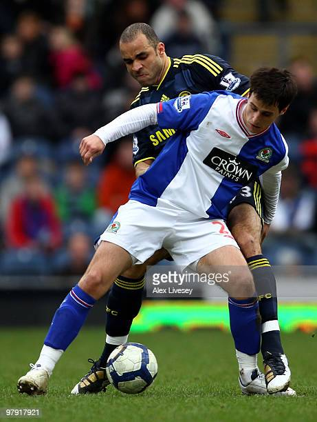 Nikola Kalinic of Blackburn Rovers tussles for posession with Alex of Chelsea during the Barclays Premier League match between Blackburn Rovers and...