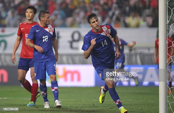 Nikola Kalinic of Croatia celebrates after scoring a goal during the international friendly match between South Korea and Croatia at the Jeonju World...