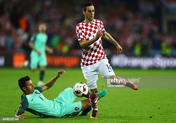 Nikola Kalinic of Croatia is tackled by Jose Fonte of Portugal during the UEFA EURO 2016 round of 16 match between Croatia and Portugal at Stade...