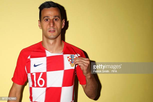 Nikola Kalinic of Croatia poses for a portrait during the official FIFA World Cup 2018 portrait session at Woodland Rhapsody Resort on June 12 2018...