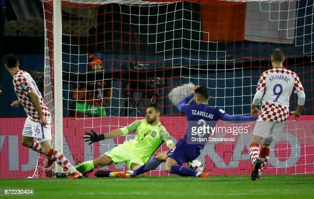 Nikola Kalinic of Croatia scores a goal past goalkeeper Orestis Karnezis of Greece during the FIFA 2018 World Cup Qualifier PlayOff First Leg between...