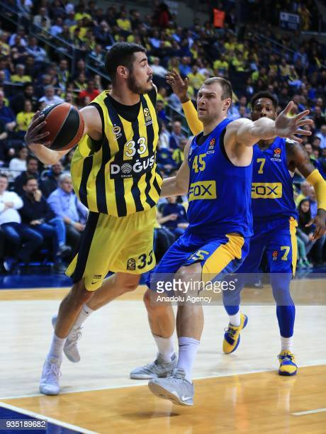 Nikola Kalinic of Fenerbahce Dogus in action against Deandre Kane and Artsiom Parakhouski of Maccabi Fox during the Turkish Airlines Euroleague week...