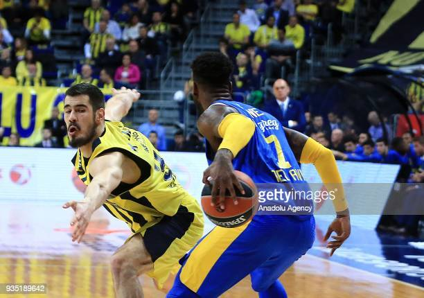 Nikola Kalinic of Fenerbahce Dogus in action against Deandre Kane of Maccabi Fox during the Turkish Airlines Euroleague week 27 basketball match...