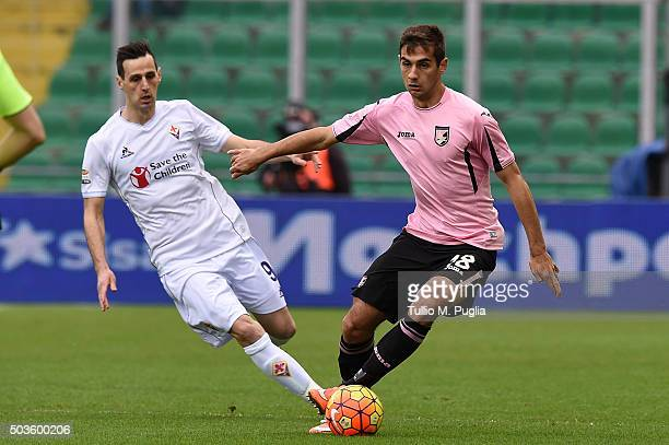 Nikola Kalinic of Fiorentina and Ivaylo Chochev of Palermo compete for the ball during the Serie A match between US Citta di Palermo and ACF...