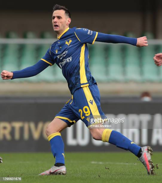 Nikola Kalinic of Hellas Verona celebrates after scoring the opening goal during the Serie A match between Hellas Verona FC and FC Crotone at Stadio...