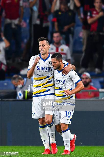 Nikola Kalinic of Hellas Verona celebrates with his team-mate Gianluca Caprari after scoring a goal during the Serie A match between Genoa CFC and...