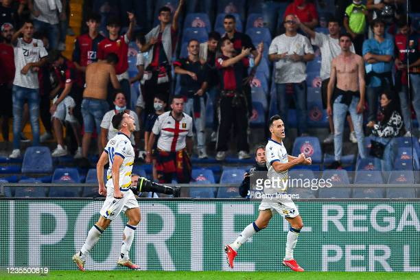 Nikola Kalinic of Hellas Verona celebrates with his team-mate Nicolò Casale after scoring a goal during the Serie A match between Genoa CFC and...