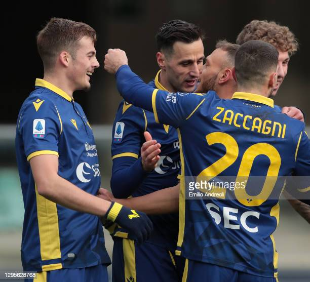 Nikola Kalinic of Hellas Verona celebrates with his team-mates after scoring the opening goal during the Serie A match between Hellas Verona FC and...
