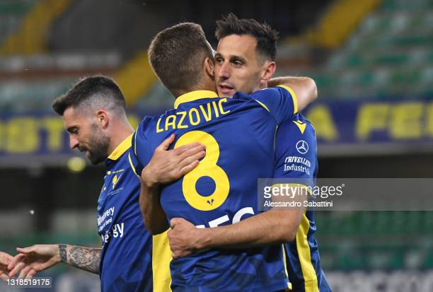 Nikola Kalinic of Hellas Verona F.C. Celebrates with Darko Lazovic after scoring his team's second goal during the Serie A match between Hellas...