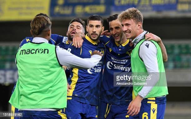 Nikola Kalinic of Hellas Verona F.C. Celebrates with his team mates after scoring his team's second goal during the Serie A match between Hellas...