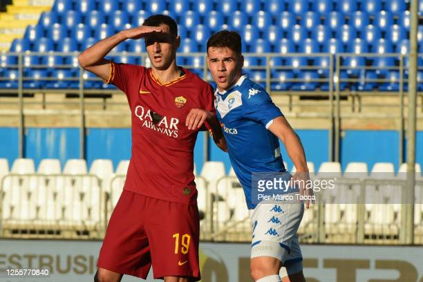 Nikola Kalinic of S Roma and Andrea Papetti of Brescia Calcio look during the Serie A match between Brescia Calcio and AS Roma at Stadio Mario...