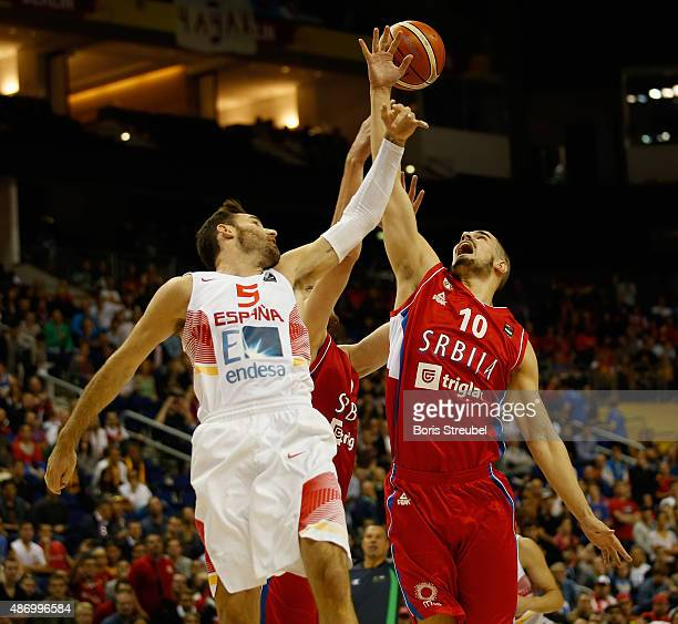 Nikola Kalinic of Serbia drives to the basket against Rudy Fernandez of Spain during the FIBA EuroBasket 2015 Group B basketball match between Spain...