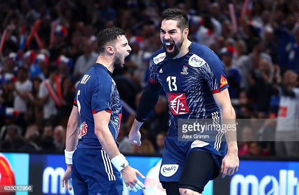 Nikola Karabatic and Nedim Remili of France celebrate victory during the 25th IHF Men's World Championship 2017 Final between France and Norway at...