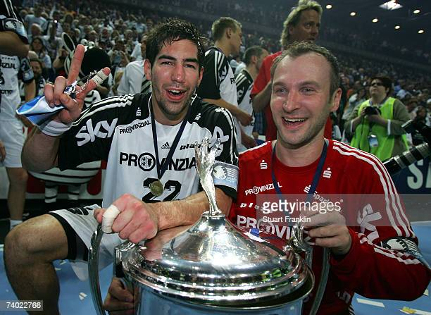 Nikola Karabatic and Thierry Omeyer of Kiel celebrate with the trophy after winning the Champions League second leg final between THW Kiel and SG...
