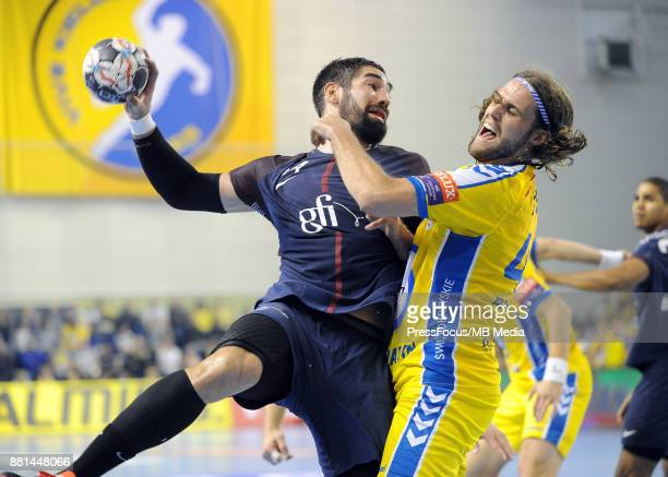 Nikola Karabatic Dean Bombac during the EHF Men's Champions League Game between PGE Vive Kielce and PSG Handball on November 26 2017 in Kielce Poland