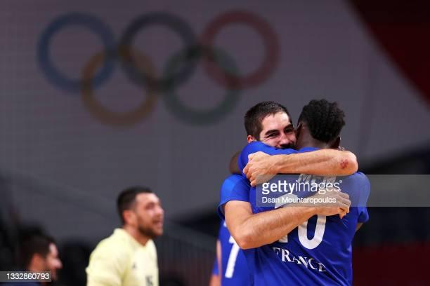 Nikola Karabatic embraces teammate Dika Mem of Team France after defeating Team Denmark 25-23 to win the gold medal in Men's Handball on day fifteen...