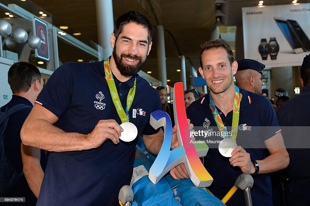 Nikola Karabatic, handball silver medalist, and Renaud Lavillenie, pole vault silver medalist, arrive at Roissy Charles de Gaulle airport after the Olympic Games in Rio on August 23, 2016 in Paris, France. Team France finished seventh in the medal table at the Rio Olympics, with a total of 42 medals.