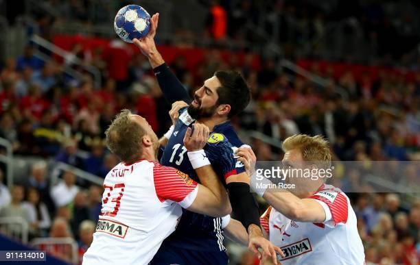 Nikola Karabatic of France challenge Henrik Toft Hansen and Anders Zachariassen of Denmark during the Men's Handball European Championship 3rd place...