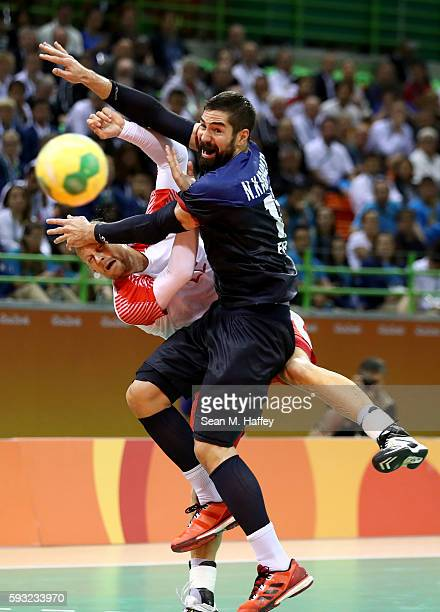 Nikola Karabatic of France defends Kasper Sondergaard of Denmark during the Men's Gold Medal Match between Denmark and France on Day 16 of the Rio...