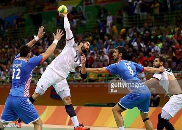Nikola Karabatic of France is challenged by Ivan Sliskovic and Marko Kopljar of Croatia during the Men's Handball preliminary Group A match between...