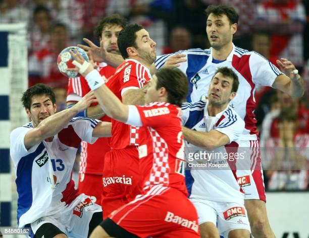 Nikola Karabatic of France tackles Ivan Cupic of Croatia during the Men's World Handball Championships final match between France and Croatia at the...