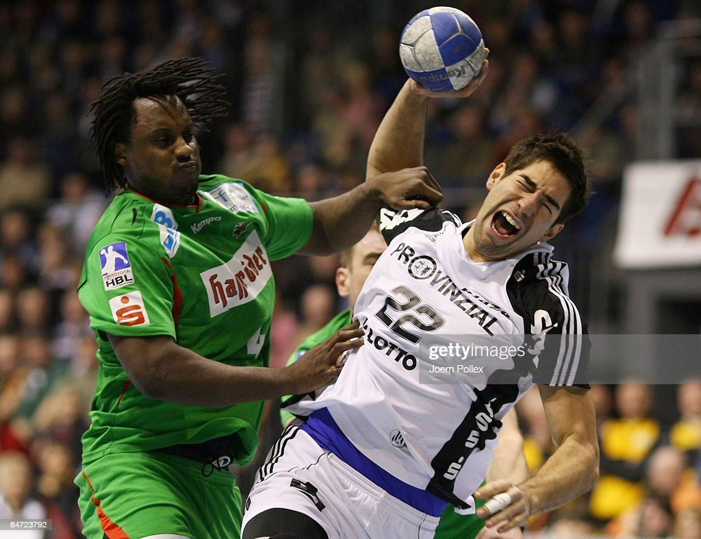 Nikola Karabatic of Kiel (R) is attacked by Damien Kabengele of Magdeburg (L) during the Toyota Handball Bundesliga match between SC Magdeburg and THW Kiel at the Boerdeland hall on February 10, 2009 in Magdeburg, Germany.