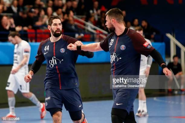 Nikola Karabatic of Paris Saint Germain is celebrating a goal with Luka Karabatic of Paris Saint Germain during the Champions League match between...