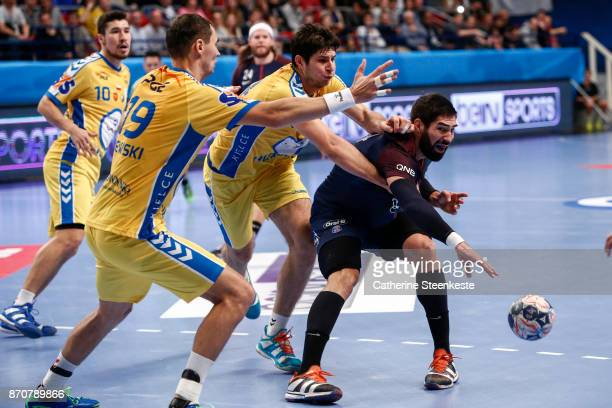 Nikola Karabatic of Paris Saint Germain is passing the ball against Marko Mamic and Krzysztof Lijewski of PGE Vive Kielce during the Champions League...