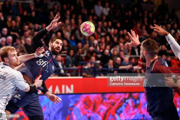 Nikola Karabatic of Paris Saint Germain is passing the ball to Luka Karabatic of Paris Saint Germain during the Lidl Starligue match between Paris...