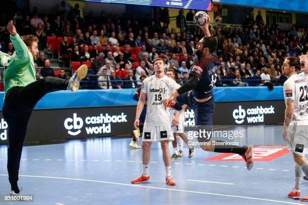 Nikola Karabatic of Paris Saint Germain is shooting the ball against Andreas Wolff of THW Kiel during the Champions League match between Paris Saint...