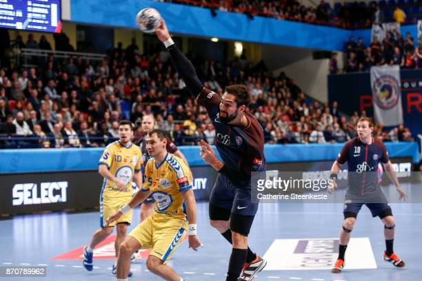 Nikola Karabatic of Paris Saint Germain is shooting the ball during the Champions League match between Paris Saint Germain and PGE Vive Kielce at...