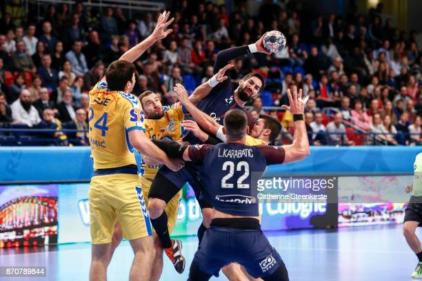 Nikola Karabatic of Paris Saint Germain is trying to pass the ball to Luka Karabatic of Paris Saint Germain against Alex Dujshebaev Dovichebaeva...