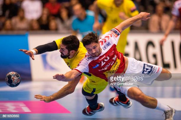 Nikola Karabatic of Paris SaintGermain and Jesper Meinby Pedersen of Aalborg Handball vie for the ball during the Men's Champions League Group Phase...