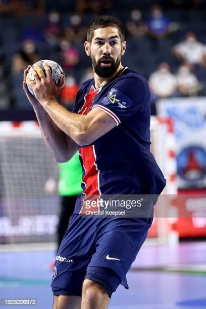 Nikola Karabatic of Paris Saint-Germain passes the ball during the VELUX EHF Champions League FINAL4 semi-final between Aalborg Handbold v Paris...