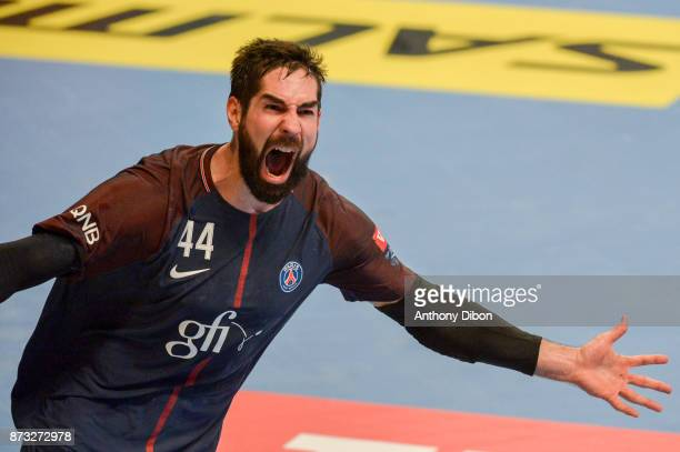 Nikola Karabatic of PSG celebrates during the Champions League match between Paris Saint Germain and Veszprem on November 12 2017 in Paris France