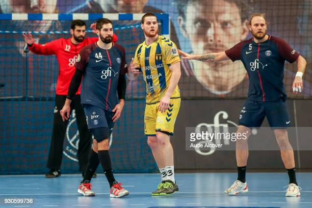 Nikola Karabatic of Psg Jeremie Courtois of Tremblay and Henrik Mollgaard of Psg during the French Cup match between Paris Saint Germain and Tremblay...