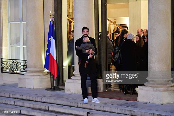 Nikola Karabatic of the France handball team who have just won the World Championships holds his son Alek as he arrives to meet with French president...