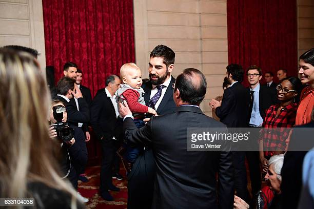 Nikola Karabatic of the France handball team who have just won the World Championships introduces his son Alek to French president Francois Hollande...