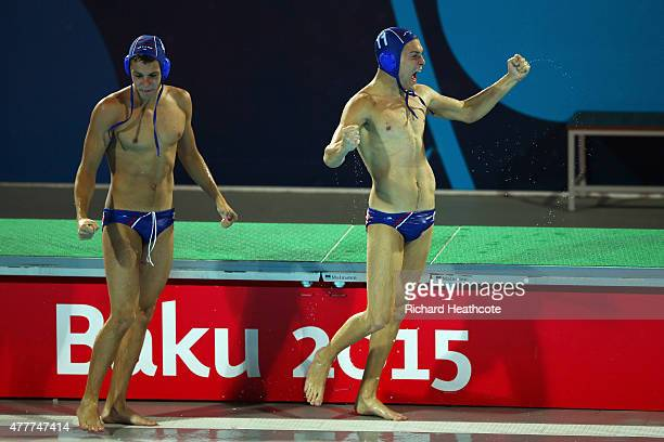 Nikola Lukic and Petar Kasum of Serbia celebrate victory following the Men's Waterpolo Semi Final between Greece and Serbia during day seven of the...