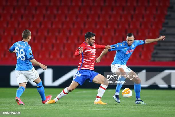 Nikola Maksimović of SSC Napoli battles for possession with Jorge Molina of Granada CF during the UEFA Europa League Round of 32 match between...