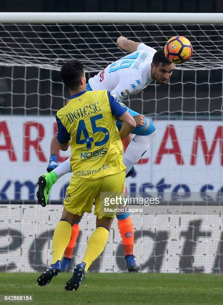 Nikola Maksimovic of Napoli and Roberto Inglese of Chievo compete for the ball during the Serie A match between AC ChievoVerona and SSC Napoli at...