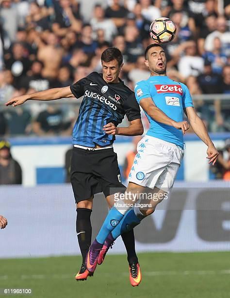 Nikola Maksimovic of Napoli competes for the ball in air with Aleksandar Pesic of Atalanta during the Serie A match between Atalanta BC and SSC...