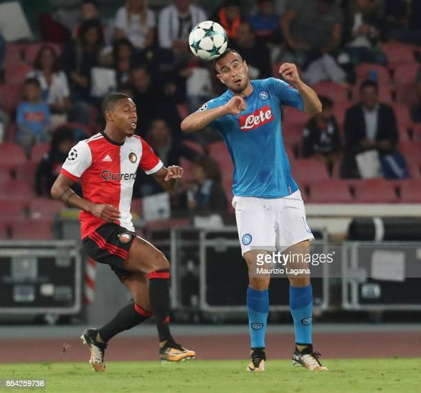 Nikola Maksimovic of Napoli competes for the ball in air with Tonny Vilhena of Feyenoord during the UEFA Champions League group F match between SSC...