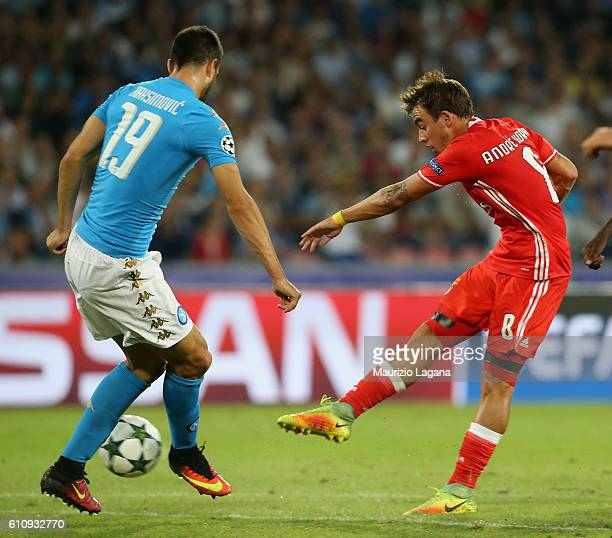 Nikola Maksimovic of Napoli competes for the ball with Andrè Horta of Benfica during the UEFA Champions League match between SSC Napoli and Benfica...