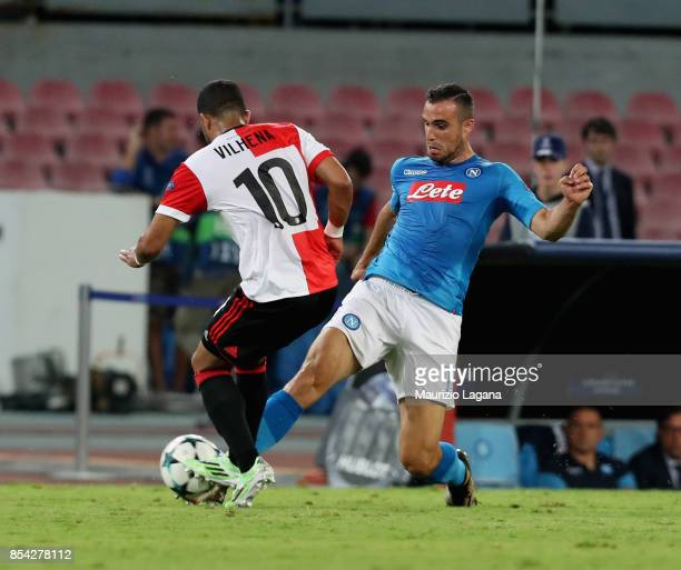 Nikola Maksimovic of Napoli competes for the ball with Tonny Vilhena of Feyenoord during the UEFA Champions League group F match between SSC Napoli...