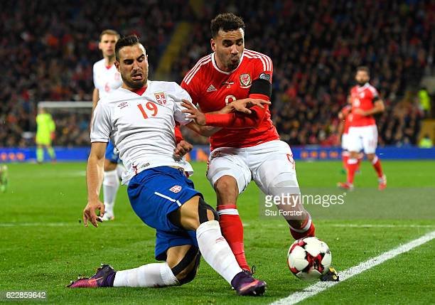 Nikola Maksimovic of Serbia challenges Hal RobsonKanu of Wales during the FIFA 2018 World Cup Qualifier between Wales and Serbia at Cardiff City...