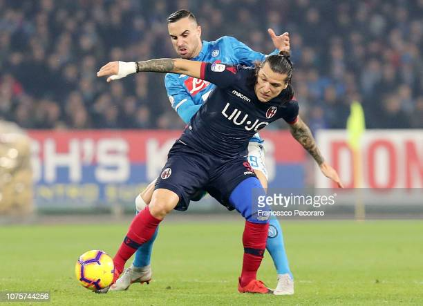 Nikola Maksimovic of SSC Napoli vies Federico Santander of Bologna FC during the Serie A match between SSC Napoli and Bologna FC at Stadio San Paolo...
